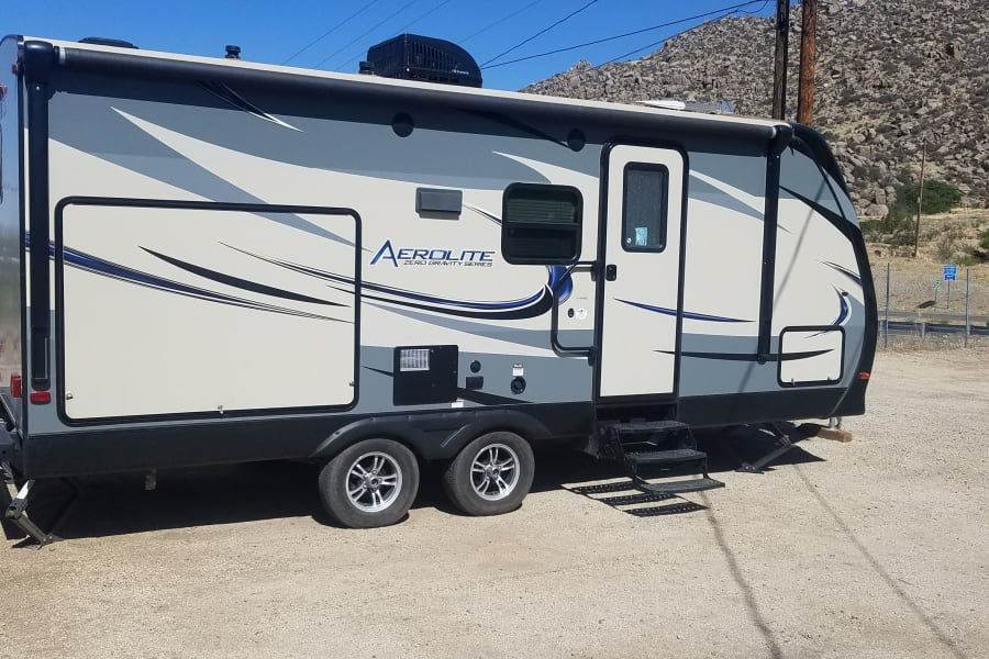 Like new, 2016 24' Travel Trailer with outdoor kitchen, perfect for those getaways with the kids, able to cook outdoors, and enjoy mother nature.