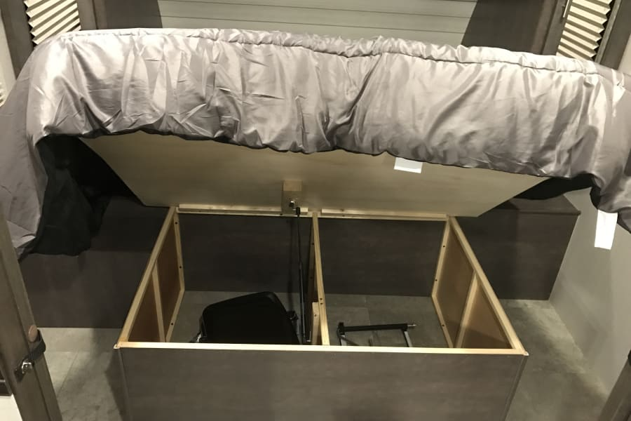 Storage under the bed. Hydraulic arms hold the lid up for the user.