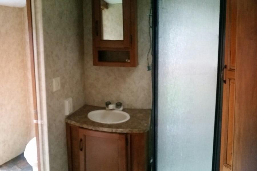 Bathroom includes corner shower.
