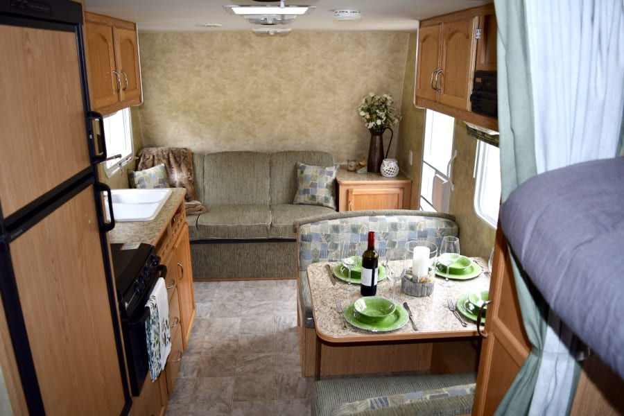 Beautiful clean kitchen, dining and relaxing area. Enjoy a camp cooked meal or a challenge in a game of cards.
