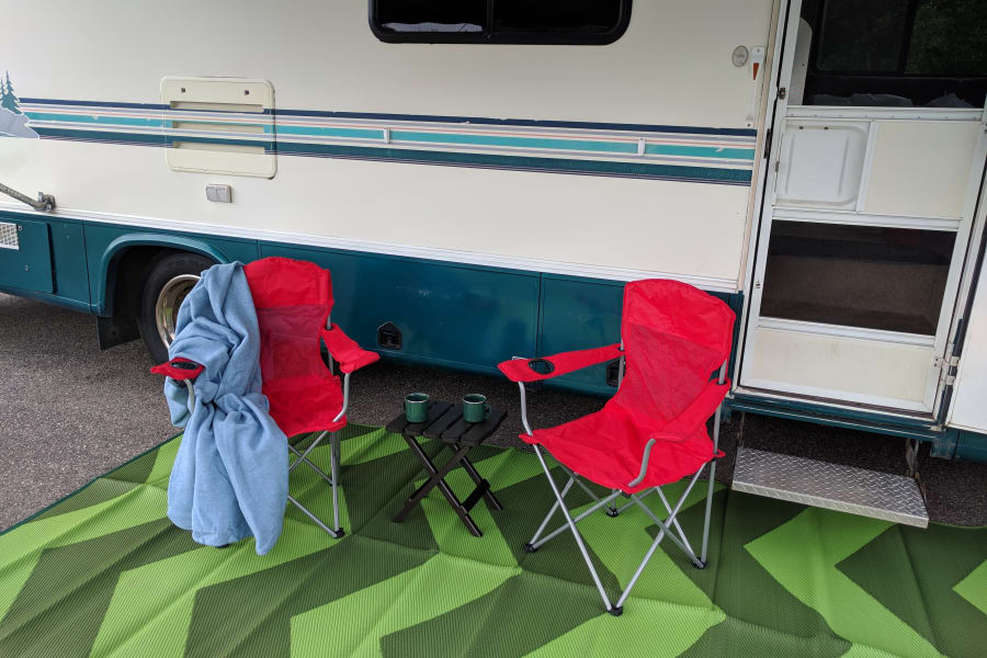 Two folding chairs, small table, and ground mat are included for your convenience.
