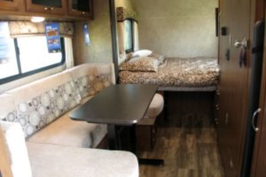 U-Shape Dinnette, Queen bed, pantry, closet, and wetbath doors.
