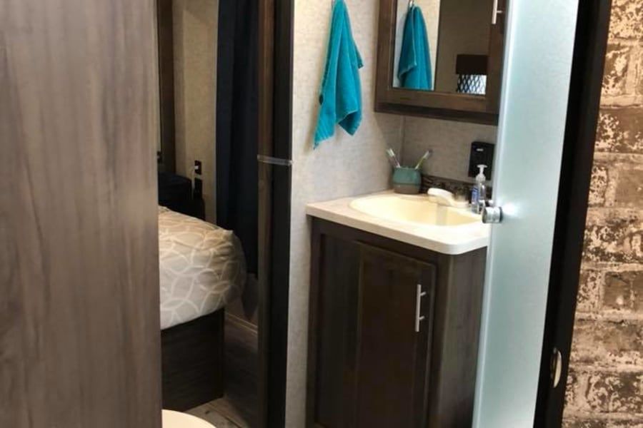 Bathroom has plenty of space and a walk-in shower