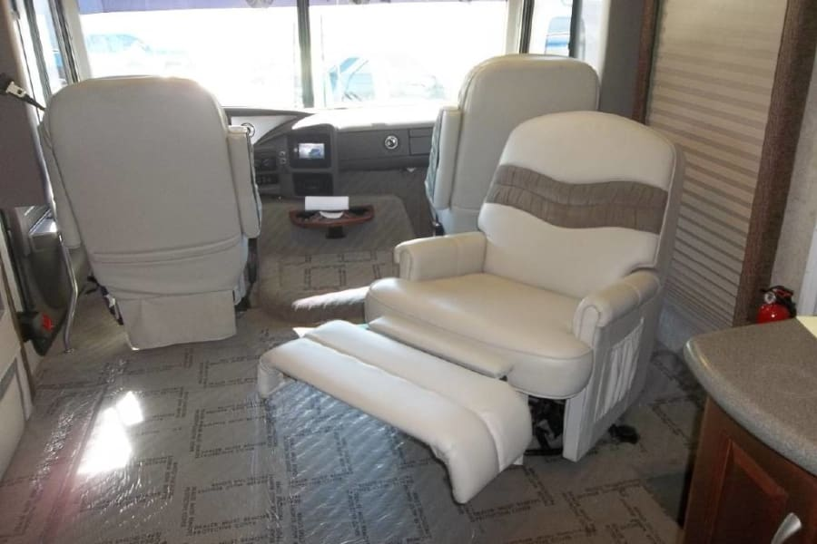 Photo of front seats and reclining captain's chair