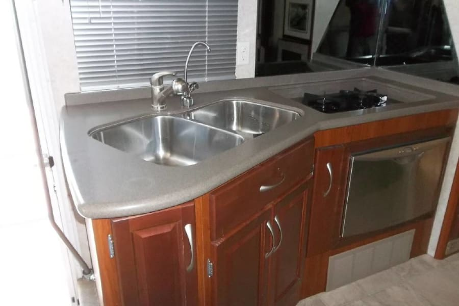 Kitchen - sink, stove, and dish washer.