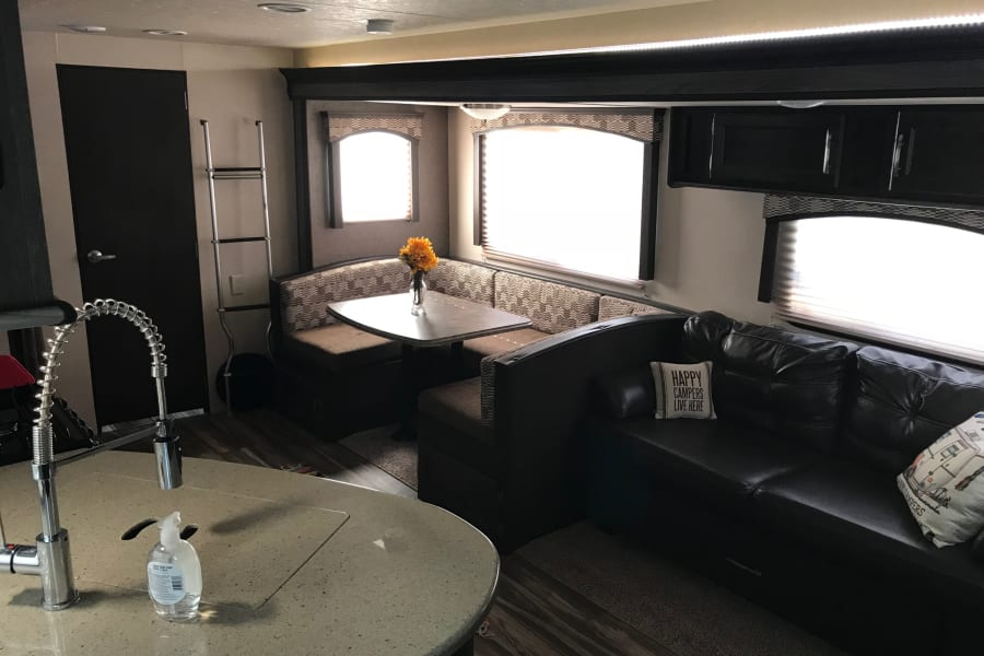 Roomy dinette and leather sofa.