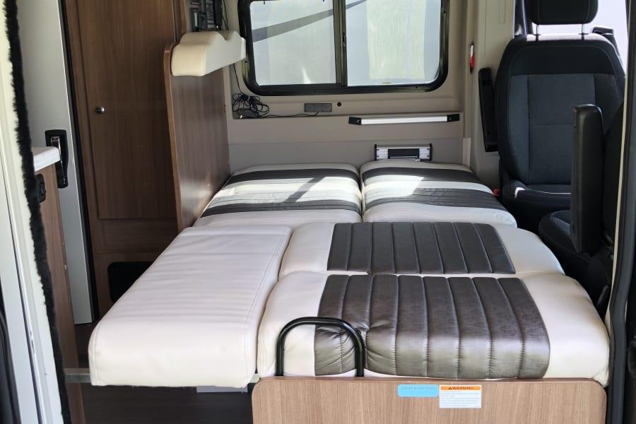 Forward sleeping area, dinette fold down.