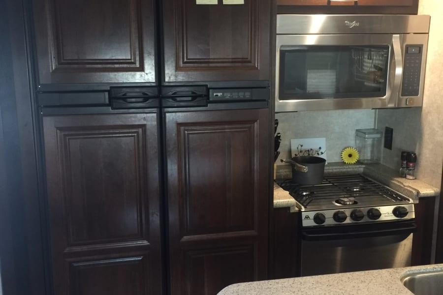Kitchen w/Large Fridge, 3 burner stove w/Oven & Large Micro