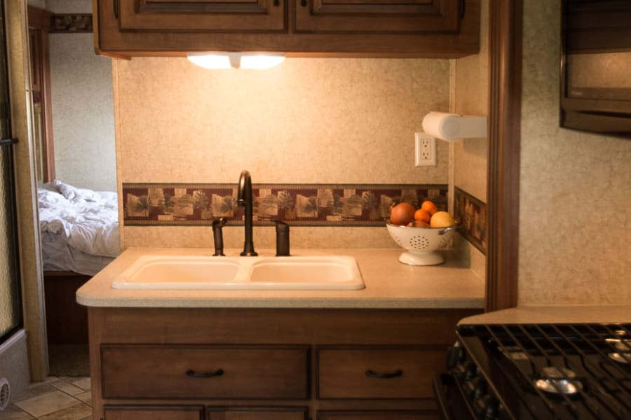 Kitchen sink with counter space.