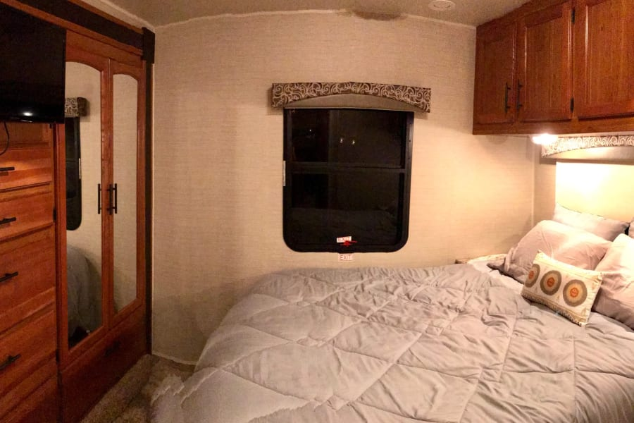 Master bedroom with queen size bed and lots of closet and storage space