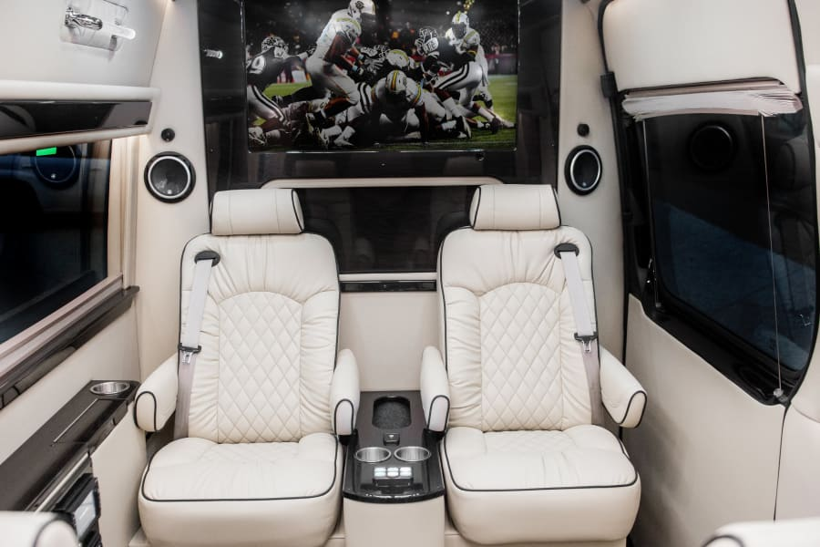 """4 total captain's chairs with 40"""" TVs (including AppleTV and WiFi)"""