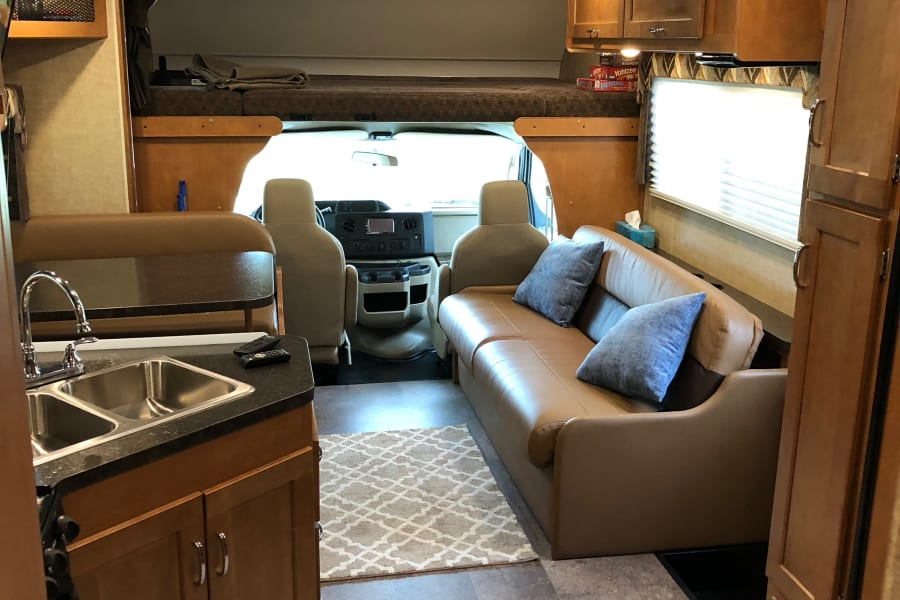 This class C RV offers seating that is functional for a group. The indoor seating is together rather than separate from each other.