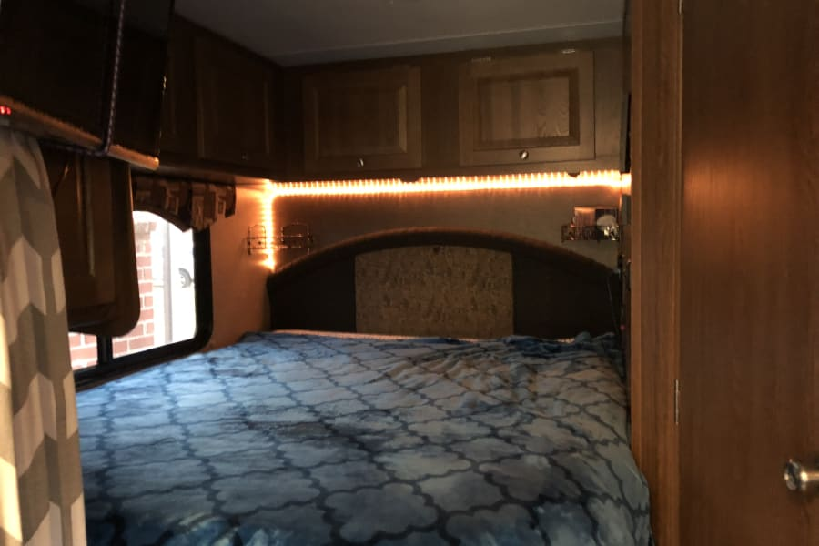 Pillow-top Queen size bed with added rope lighting.