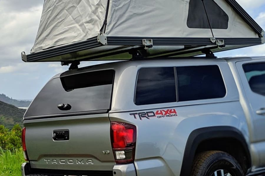 2018 Toyota Tacoma TRD Off Road with a GFC Rooftop Tent. Tent can be raised in about 30 seconds. Tent contains a comfortable bed that sleeps 2.