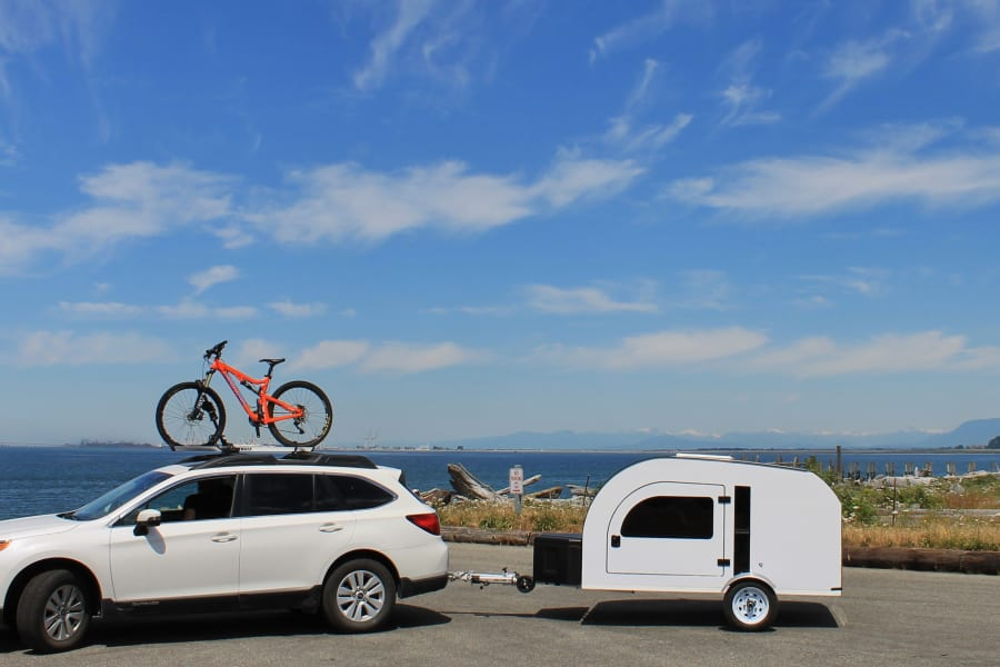 Lightweight (950lbs) camping trailer. DROPLET can be towed by most small/medium size cars. Check specs on droplet-trailer.com to see if your car is compatible.