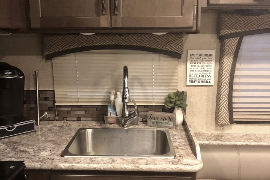 The gourmet RV kitchen has plenty of storage and space to cook.  Don't forget your K-cups because we also include a Keurig.