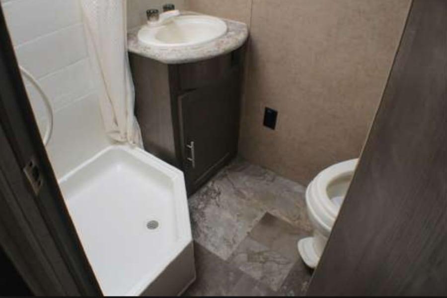 Roomy bathroom...also has a hair dryer.