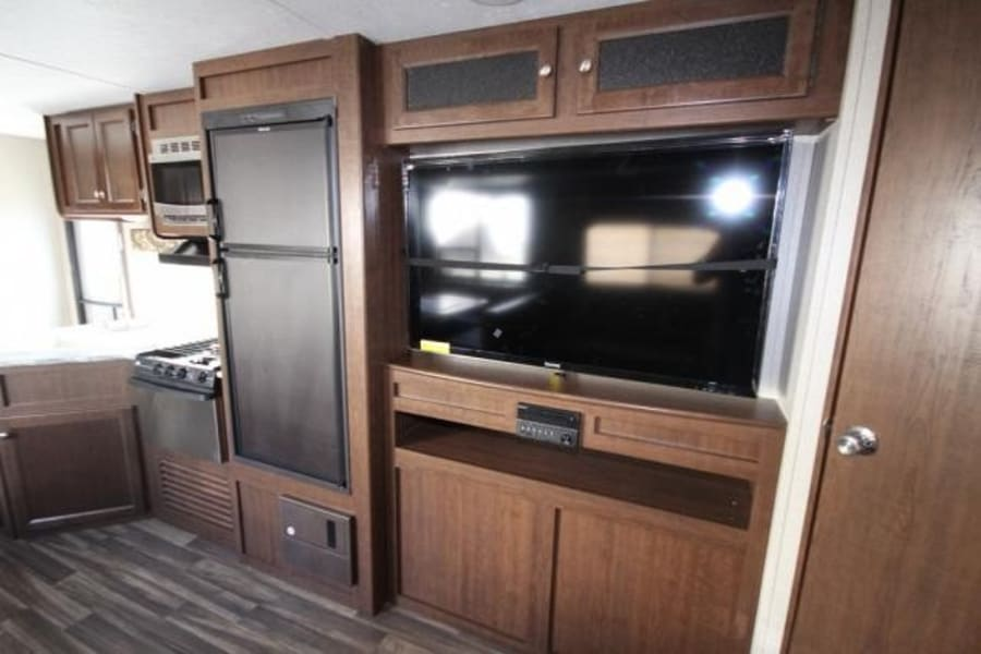 Big Screen Television and surround sound entertainment system viewable from entire living, dining and bunk rooms.