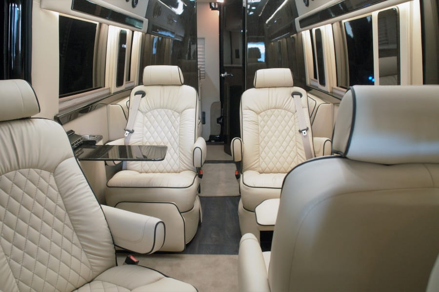 Everyone Rides in Luxury with Maybach Leather Captains Chairs. There's fold out tables for your laptop or whatever you might need it for.