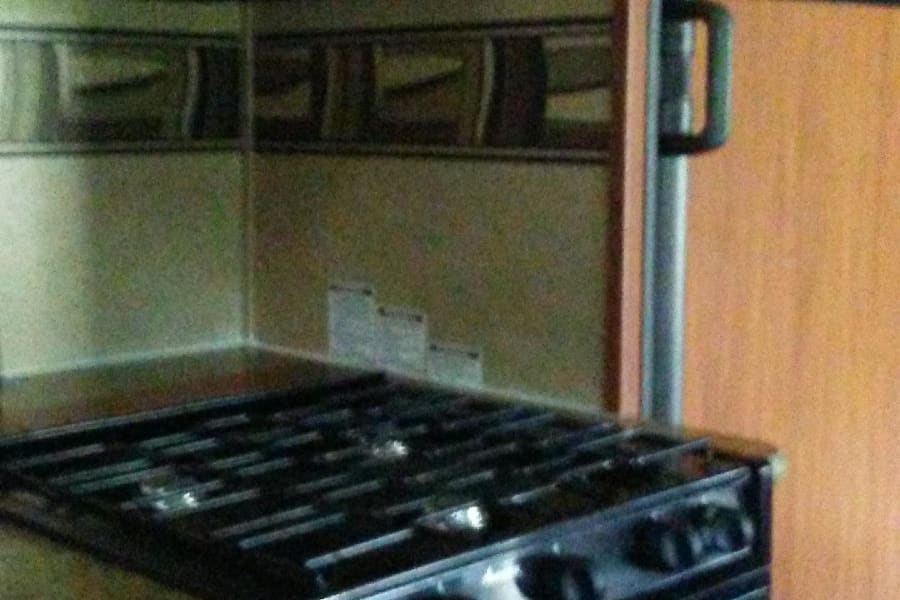 Gas stove with oven.