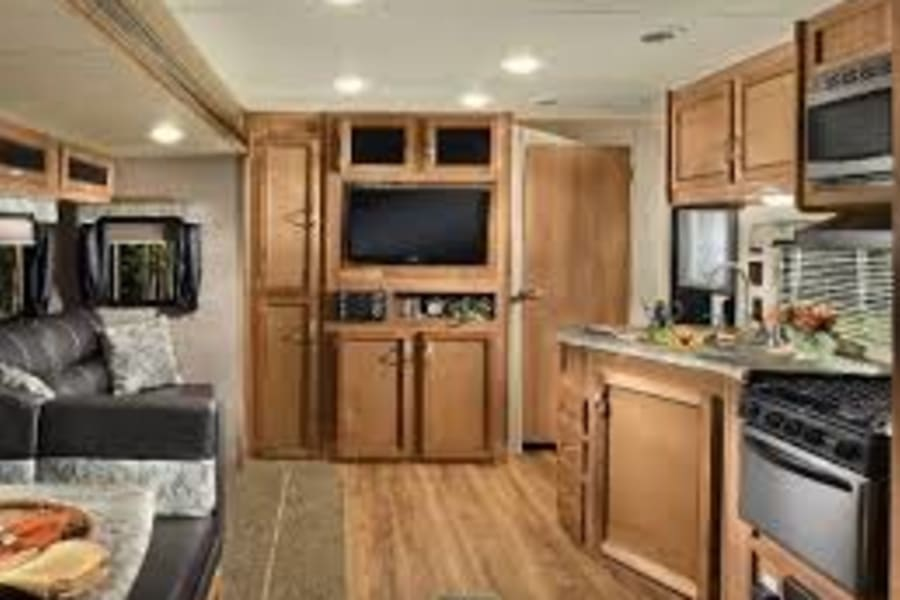 Interior features modern conveniences: gas stove/oven, reliable refrigerator, flat screen TV, all-in-one entertainment station, very easy Bluetooth hookup and surround sound speakers (indoors and out!).
