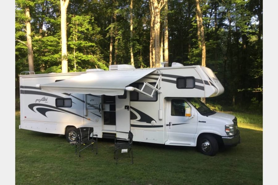 """""""Ramblin' Rose"""" is the ultimate vacation home away from home!  Named after beloved Rose Hoffman, who at 80, snuck off in her RV to visit her sister in Colorado without letting anyone know!  What a gal!This sparkling Class C RV comfortably sleeps 8-10 and comes to you complete with linens, cookware, campfire chairs, games, DVDs and much more.  Just pack your personal toiletries, clothes (don't forget your medications if you need them!) and get set for an unforgettable  vacation!  Do I hear """"Road Trip"""" anyone? """"Rose"""" loves tailgating at football games!  Special pricing available for tailgating!  **Not responsible for personal items left behind in the RV**"""