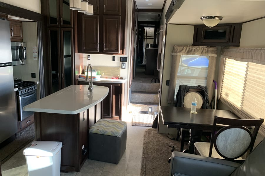 Dinette(extra chairs in under bed storage and basement). Beautiful kitchen stocked with pots and pans and plenty of storage!