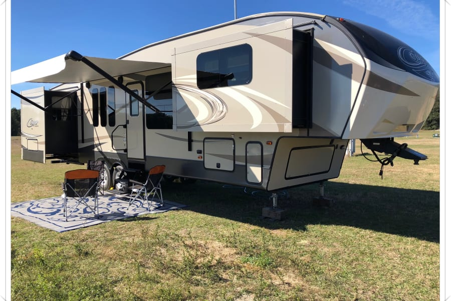 Our four slide-out RV expands into a roomy home away from home.  Just show up with your food and personal items and step into an RV that is fully setup from the bedroom to the living room to a comfortable outdoor setting.