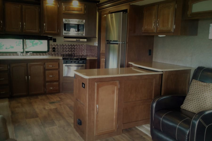 Spacious kitchen, large refrigerator, lots of countertop and cabinets. Some kitchen supplies provided.