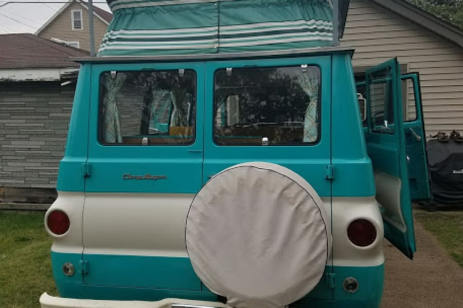 The rear of the CampWagon, showing spare tire and poptop up.