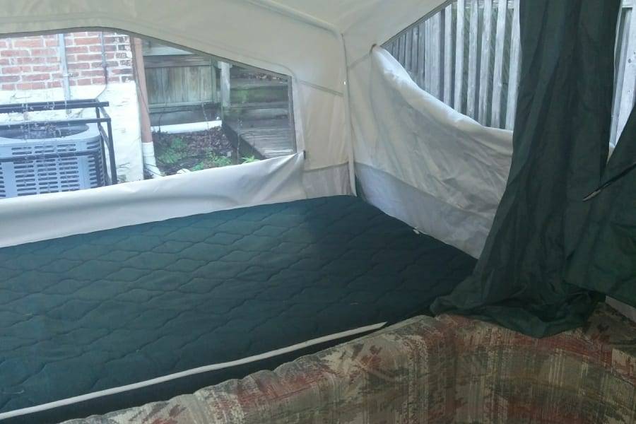 """Kid's end"". Queen size bed with Ikea mattress and heater. Sleeps 2"