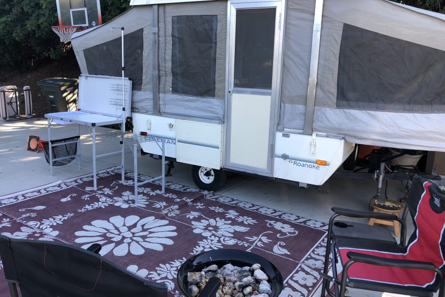 Set up with sink and dirt mat in front of trailer