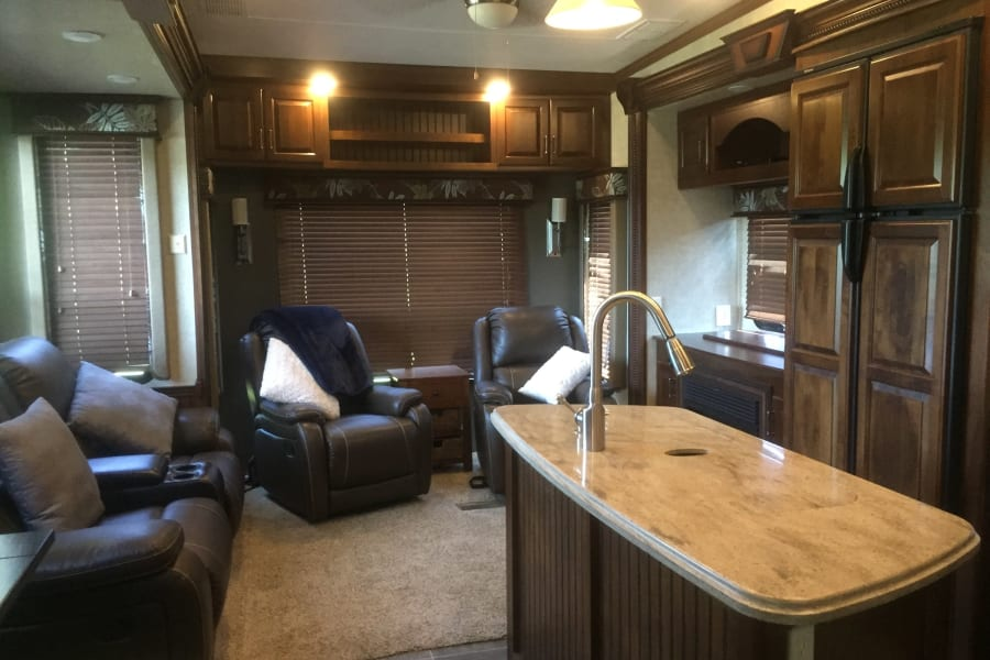 Living Area, reclining love seat and 2 swivel recliners