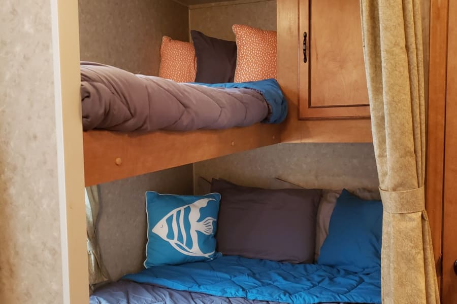 upper bunk twin bed, bed below double bed. All fresh linens and pillows provided.