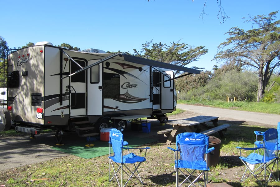Campers view, great access to the trailer from both the master bedroom and kitchen areas. Nice large electric awning, exterior speakers and LED lighting for all of your outside camping needs.
