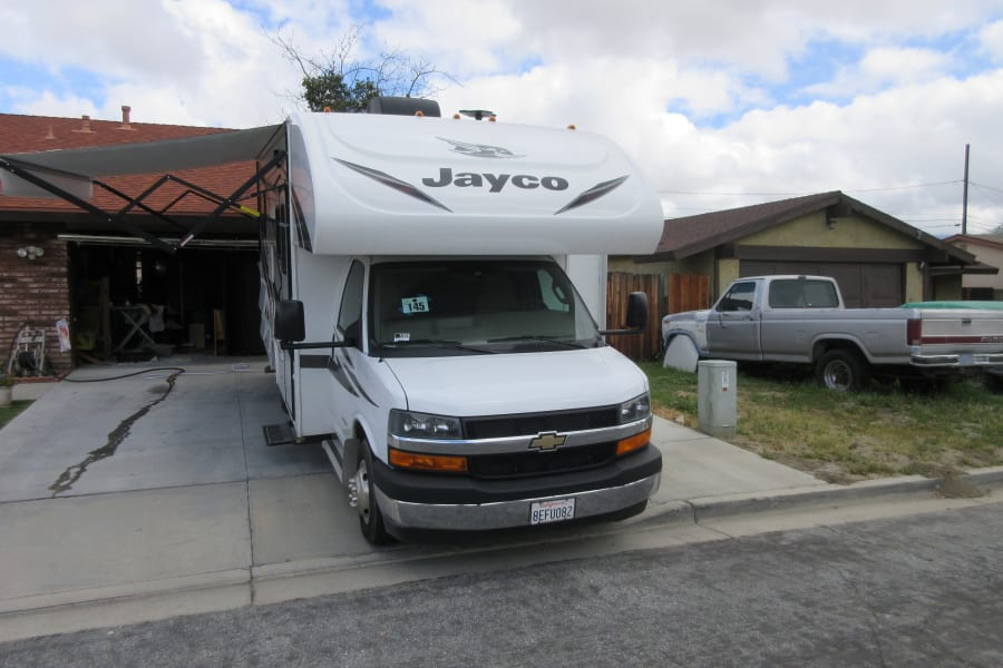 Front view of the RV with the awning out.