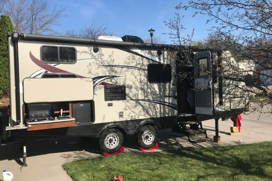 Outside of the camper including outdoor kitchen.