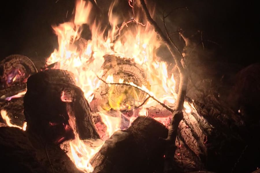 Doing marshmallows or making smores. What better way to end your day by a cozy campfire.