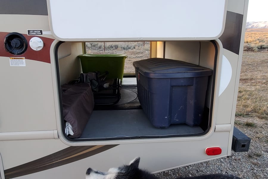 Big storage area, fold up camping table is built in to the storage bin.