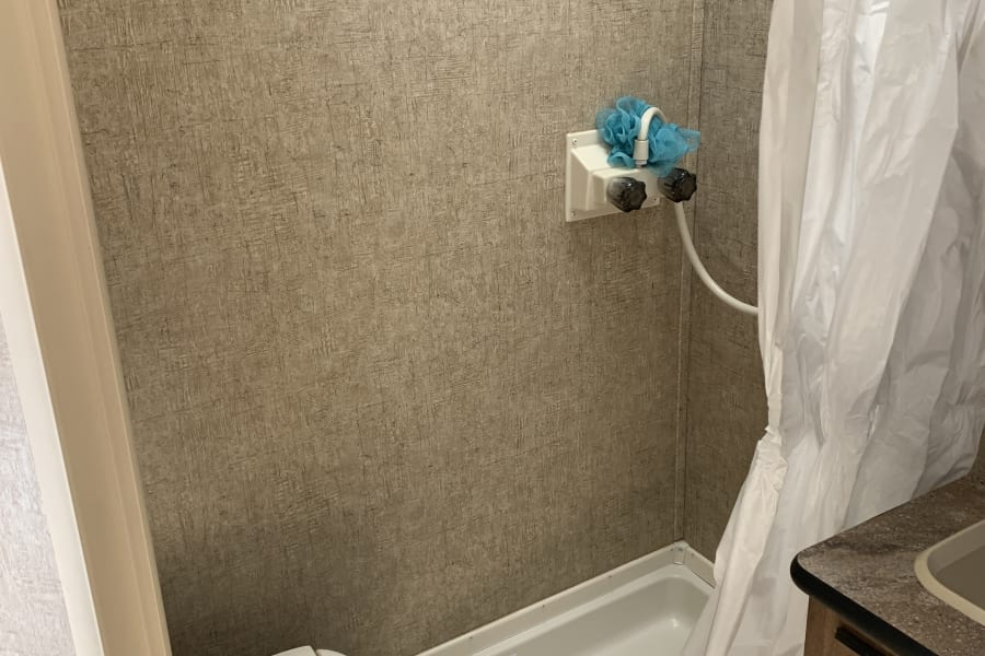 Spacious shower with 6 gallon water heater.