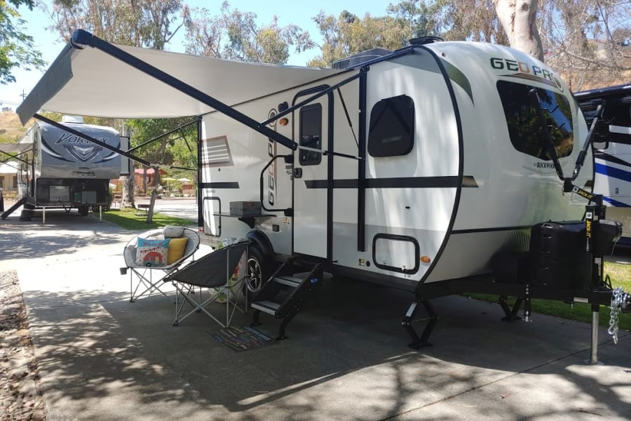 The bike rack is attached to the front of the travel trailer.