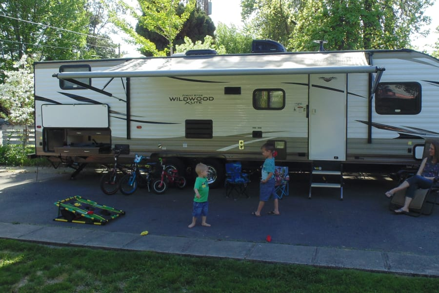The awning for shade, the exterior BBQ, outdoor sink, counter and refrigerator help you make the most of your camping experience.