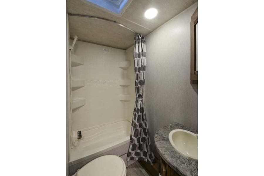 Bathroom has a full shower and even a small sized tub.  A sky light above the showers lets you keep the space airy.