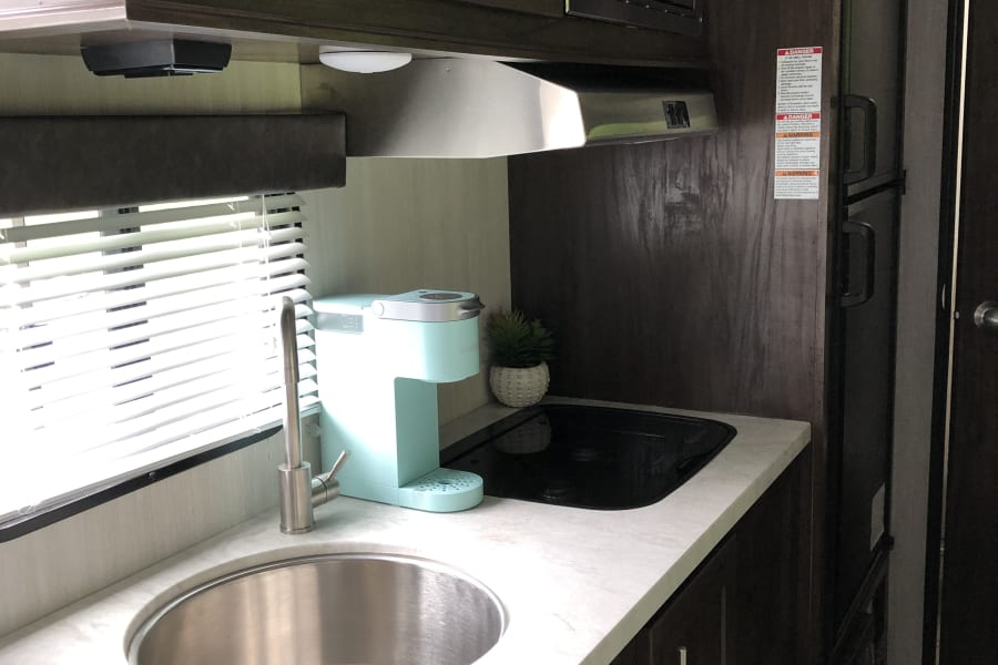 Stove, deep sink and even a Keurig single cup coffee machine!