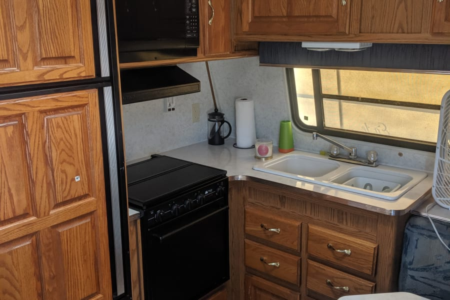 Kitchen stove microwave and vent fan.
