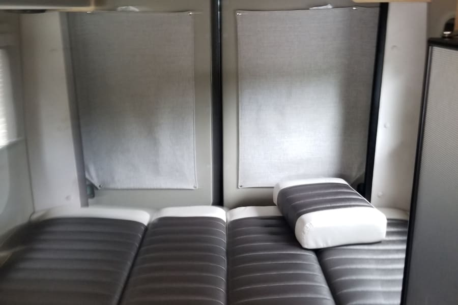 This is the back of the van configured in a bed setup.  The other configuration is a dining area.