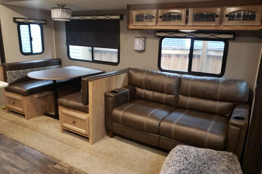 Dinning table and couch. Both fold down into beds.