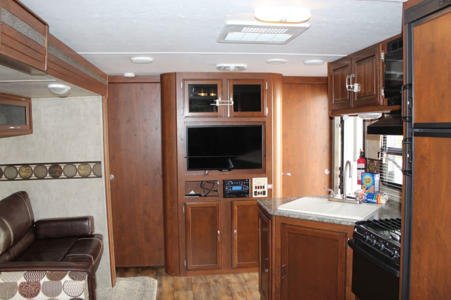 Create fun family memories in this spacious, cozy, inviting, cabin like interior.