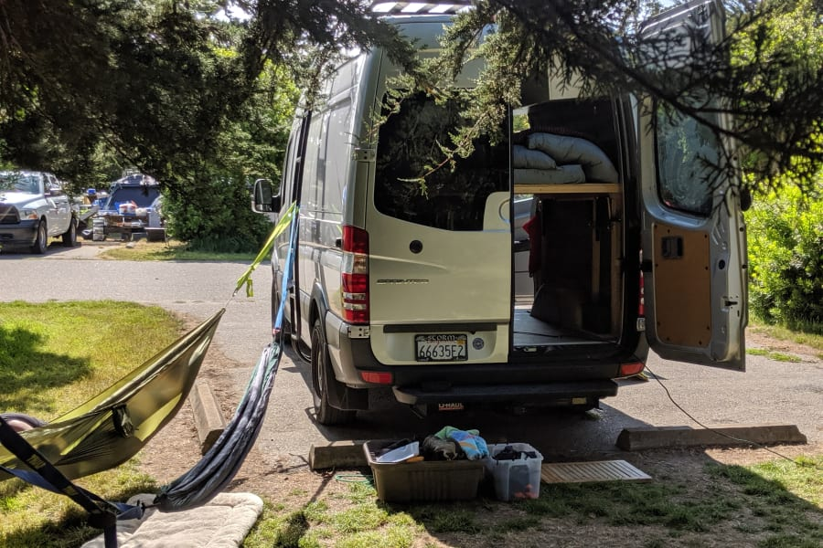 We'll include two hammocks and some straps, the roof rack or ladder is perfect for anchoring one end, all you need to do is find a sturdy tree!