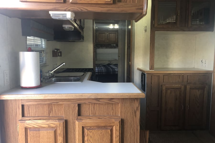 The spacious kitchen and dining area.  Stainless steel sink, 4 burner stove, and a microwave make this kitchen a perfect base camp.
